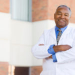 Doctor Standing Outside A Hospital