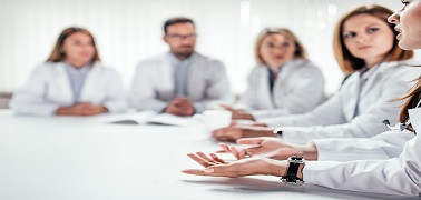 Cropped image of medical doctors discussing during the conference. Copy space.